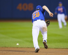 November 1, 2015: New York Mets second baseman Daniel Murphy (28) [7008] makes a error during the twelfth inning of Game 5 of the 2015 World Series between the Kansas City Royals and the New York Mets at Citi Field in Flushing, NY. (Photo by Joshua Sarner/Icon Sportswire)