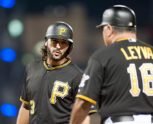 August 3 2015: Pittsburgh Pirates first baseman Sean Rodriguez (3) talks with first base coach Nick Leyva (16) after walking during the third inning in the game between the Chicago Cubs and Pittsburgh Pirates at PNC Park in Pittsburgh, Pennsylvania
