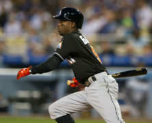 28 April 2016: Miami Marlins Second base Dee Gordon (9) [7422] hits an infield ground ball during the game between the Miami Marlins and the Los Angeles Dodgers at Dodger Stadium in Los Angeles, CA. (Photo by David Dennis/Icon Sportswire)