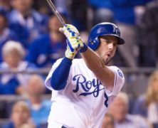 October 28, 2014: Kansas City Royals third baseman Mike Moustakas (8) hits a home run during the World Series game 6 between the San Francisco Giants and the Kansas City Royals at Kauffman Stadium in Kansas City, Missouri.  The Royals shut out the Giants 10-0 to tie the series at 3 games each.